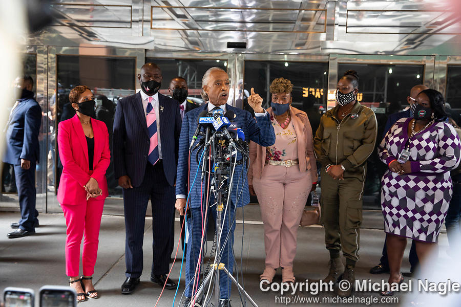 Reverend Al Sharpton, center, speaks at a press conference in response to the George Floyd and Duante Wright cases along with Benjamin Crump, attorney for the Wright family, left of center; Gwen Carr, mother of Eric Garner, right of center; Sybrina Fulton, mother of Trayvon Martin, second from right; and Sequette Clark, Mother of Stephon Clark, right; during the National Action Network (NAN) Virtual Convention 2021 in New York on Wednesday, April 14, 2021. Photograph by Michael Nagle