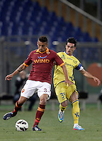 Calcio, Serie A: Roma vs Chievo Verona, Stadio Olimpico, Roma, 7 maggio  2013..AS Roma defender Marquinhos, of Brazil, left, is challenged by ChievoVerona forward Adrian Stoian, of Romania, during the Italian serie A football match between Roma and ChievoVerona at Rome's Olympic stadium, 7 maggio  2013..UPDATE IMAGES PRESS/Isabella Bonotto