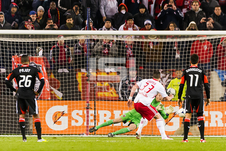 D. C. United goalkeeper Joe Willis (31) save a penalty kick by Kenny Cooper (33) of the New York Red Bulls. D. C. United defeated the New York Red Bulls 1-0 (2-1 in aggregate) during the second leg of the MLS Eastern Conference Semifinals at Red Bull Arena in Harrison, NJ, on November 8, 2012.