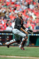 Miami Marlins catcher Miguel Olivo #21 attempts to catch a pop up during a game against the Cincinnati Reds at Great American Ball Park on April 20, 2013 in Cincinnati, Ohio.  Cincinnati defeated Miami 3-2 in 13 innings.  (Mike Janes/Four Seam Images)
