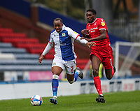 17th October 2020; Ewood Park, Blackburn, Lancashire, England; English Football League Championship Football, Blackburn Rovers versus Nottingham Forest ; Ryan Nyambe of Blackburn Rovers holds off a challenge from Alex Mighten of Nottingham Forest