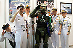 """Master Chief (Halo) poses with Japanese marines at  the Niconico Douga fan event at Makuhari Messe International Exhibition Hall on April 25, 2015, Chiba, Japan. The event includes special attractions such as J-pop concerts, Sumo and Pro Wrestling matches, cosplay and manga and various robot performances and is broadcast live on via the video-sharing site. Niconico Douga (in English """"Smiley, Smiley Video"""") is one of Japan's biggest video community sites where users can upload, view, share videos and write comments directly in real time, creating a sense of a shared watching. According to the organizers more than 200,000 viewers for two days will see the event by internet. The popular event is held in all 11 halls of the huge Makuhari Messe exhibition center from April 25 to 26. (Photo by Rodrigo Reyes Marin/AFLO)"""