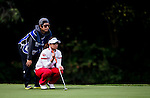 Ran Hong of Korea lines up a putt during the Hyundai China Ladies Open 2014 on December 12 2014 at Mission Hills Shenzhen, in Shenzhen, China. Photo by Li Man Yuen / Power Sport Images