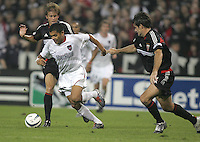 30 October,  2004.  The MetroStars' Amado Guevara (20) tries to work past the DC United defense during the 2004 MLS playoffs at RFK Stadium in Washington, DC.