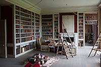 The final touches are being made to the library and the last of the books restored to the bookshelves before the furniture is put back in its original place