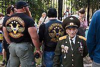 Moscow, Russia, 19/08/2012..A Russian army veteran walks past members of the Russian Veterans Motorcycle Club at a Russian opposition rally. Several hundred opposition demonstrators gathered near the Russian government White House to mark the 21st anniversary of the attempted coup in 1991 by Communist hardliners that led to the eventual break-up of the Soviet Union.