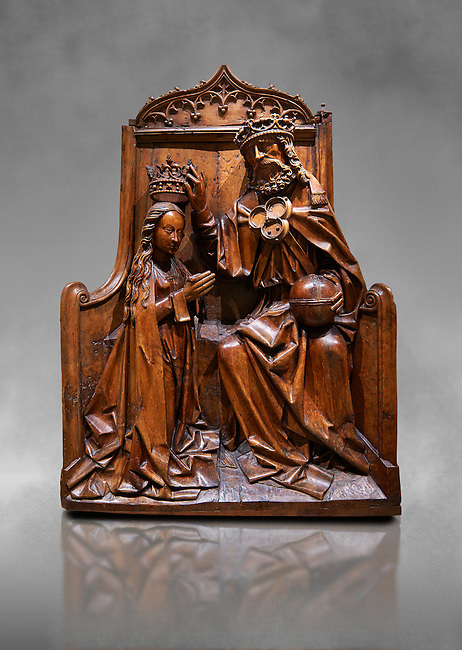 Gothic wood relief sculpture of the crwoning of of the Virgin Mary in the central European sgchiool style, end of 15th Century.  National Museum of Catalan Art, Barcelona, Spain, inv no: MNAC  5270. Against a grey art background.