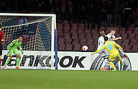 Thursday 27 February 2014<br /> Pictured: Gonzalo Higuain of Napoli (R) scores against Michel Vorm (L) making the score 2-1 to Napoli<br /> Re: UEFA Europa League, SSC Napoli v Swansea City FC at Stadio San Paolo, Naples, Italy.