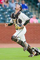 Greensboro Grasshoppers catcher Jose Behar (15) chases after a foul pop fly during the South Atlantic League game against the Charleston RiverDogs at NewBridge Bank Park on July 17, 2013 in Greensboro, North Carolina.  The Grasshoppers defeated the RiverDogs 4-3.  (Brian Westerholt/Four Seam Images)