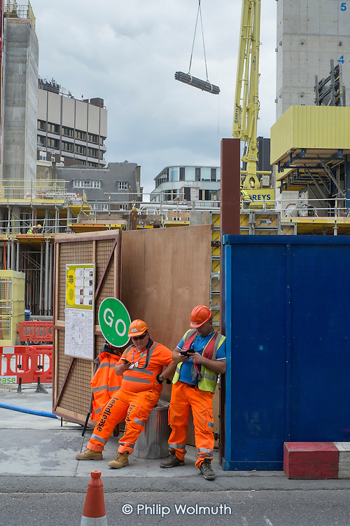 Construction workers at Rathbone Square, a 2.3 acre office, retail and residential redevelopment by Great Portland Estates behind Oxford Street, central London.
