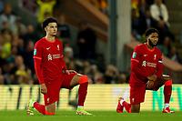 21st September 2021; Carrow Road, Norwich, England; EFL Cup Footballl Norwich City versus Liverpool; Curtis Jones and Joe Gomez take the knee