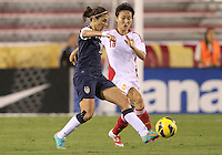 BOCA RATON, FL - DECEMBER 15, 2012: Carli Lloyd (10) of the USA WNT passes away from Wang Chen (16) of China WNT during an international friendly match at FAU Stadium, in Boca Raton, Florida, on Saturday, December 15, 2012. USA won 4-1.