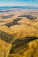 Aerial view of fire risk management with controlled burns of the grasslands at wind turbines northern California Contra Costa county, California.
