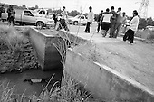 Culiacan, Mexico<br /> June 13, 2007<br /> <br /> A drug related execution, adding to the more then 300 this year in Cuilacan. Francisco de Jesús Ibarra, 33 was found lying in a canal on the outskirts of San Pedro. He had been beaten and shot in the head. . .Family members break down and cry as his body is removed from the canal.