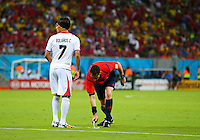 Referee Benjamin Williams sprays the vanishing spray to mark where the wall must stand for a free kick