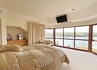 BNPS.co.uk (01202) 558833. <br /> Pic: LillicrapChilcott/BNPS<br /> <br /> Pictured: Principal bedroom. <br /> <br /> An impressive waterfront home with panoramic views over one of Britain's most popular estuaries is on the market for £2.75m.<br /> <br /> Tregytreath is the perfect property for boat lovers, with access to the foreshore and its own private jetty onto the water.<br /> <br /> The five-bedroom house is in Restronguet Point, one of the most exclusive waterside locations in Cornwall, and this property has one of the most outstanding positions among those prestigious homes.<br /> <br /> The house was designed and built, by the current owners 20 years ago, to make the most of the beautiful views.