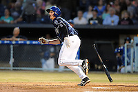 Asheville Tourists third baseman Ryan McMahon #5 swings at a pitch during opening night game against the Delmarva Shorebirds at McCormick Field on April 3, 2014 in Asheville, North Carolina. The Tourists defeated the Shorebirds 8-3. (Tony Farlow/Four Seam Images)