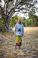 """55 year old Roycee Chisenga on safari in Kasanka National Park. """"Since the managers came in there has been rehabilitation of schools in this chiefdom and new clinics have been built. Tourists who come here from outside Zambia have never seen different types of animals the we have here, not even a python."""" Local schools and women's groups are regularly brought into Kasanka, which is unique in the country and unusual in Africa as it is privately managed and owned by a trust. People are able to see animals flourishing in land which was once free reign for poachers. Combined with anti-poaching scouts, the education programme is on the frontline of conservation methods in the park, showing local people wild animals in their natural habitat."""