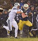 Nov. 23, 2013; Running back Cam McDaniel (33) runs the ball against BYU.<br /> <br /> Photo by Matt Cashore