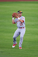 Mesa Solar Sox outfielder Caleb Adams (13) throws the ball in during an Arizona Fall League game against the Peoria Javelinas on October 21, 2015 at Peoria Stadium in Peoria, Arizona.  Peoria defeated Mesa 5-3.  (Mike Janes/Four Seam Images)