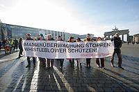 """Protest gegen Ueberwachung.<br />Anlaesslich des """"International Day of Privacy"""" #IDP14 protestierten Geheimdienstkritiker am Samstag den 2. Februar 2014 vor dem Brandenburger Tor gegen die Vorratsdatenspeicherung. Sie forderten u.a. Asyl fuer den Whistleblower Edward Snowden in Deutschland, den Schutz der Privatsphaere vor Ausspaehungen durch Geheimdienste und eine vollstaendige Aufklaerung der NSA-Abhoeraktionen.<br />1.2.2014, Berlin<br />Copyright: Christian-Ditsch.de<br />[Inhaltsveraendernde Manipulation des Fotos nur nach ausdruecklicher Genehmigung des Fotografen. Vereinbarungen ueber Abtretung von Persoenlichkeitsrechten/Model Release der abgebildeten Person/Personen liegen nicht vor. NO MODEL RELEASE! Don't publish without copyright Christian-Ditsch.de, Veroeffentlichung nur mit Fotografennennung, sowie gegen Honorar, MwSt. und Beleg. Konto:, I N G - D i B a, IBAN DE58500105175400192269, BIC INGDDEFFXXX, Kontakt: post@christian-ditsch.de<br />Urhebervermerk wird gemaess Paragraph 13 UHG verlangt.]"""