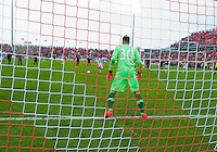 Toronto, Ontario - May 3, 2014: New England Revolution midfielder/forward Lee Nguyen #24 takes a penalty shot on Toronto FC goalkeeper Julio Cesar #30 and scoring the second goal for New England during a game between the New England Revolution and Toronto FC at BMO Field.<br /> The New England Revolution won 2-1.