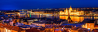 Beautiful panorama on lit-up Buda city, the Danube, and the Hungarian parliament, from the Royal Palace castle at twilight, Budapest Hungary