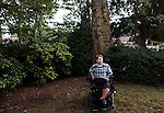 MERRICK, NY - AUGUST 15: Max Gold, who is bound to a wheelchair after losing his leg to a congenital vascular problem, poses for a portrait in the backyard of his home in Merrick, NY, on August 15, 2013. Max is suing the Smithsonian Air & Space Museum after being denied access to a flight simulator. (Photo by Yana Paskova/For The Washington Post)