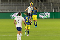 ORLANDO, FL - JANUARY 22: Emily Sonnett #14 wins a header against Diana Ospina #4 during a game between Colombia and USWNT at Exploria stadium on January 22, 2021 in Orlando, Florida.