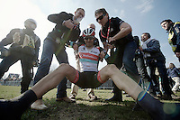 111th Paris-Roubaix 2013..Fabian Cancellara (CHE) exhausted (& happy) after winning his 3rd Paris-Roubaix. Helped back up by press officer Tim Vanderjeugd & DS Dirk Demol..