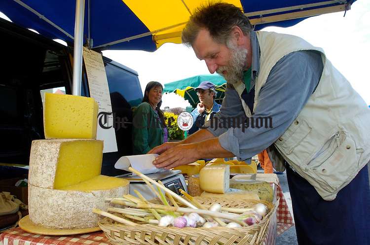 Dave Smith of Clare Cheeses in his stall at the Ennis Farmers Market. Photograph by John Kelly.