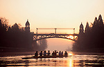 Seattle, women rowers in eight-oared racing shell rest in the Montlake Cut at sunrise, Washington State, Pacific Northwest, United States,