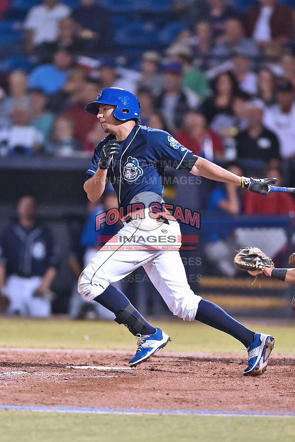Asheville Tourists right fielder Jonathan Daza (2) swings at a pitch during game 3 of the South Atlantic League Championship Series between the Asheville Tourists and the Hickory Crawdads on September 17, 2015 in Asheville, North Carolina. The Crawdads defeated the Tourists 5-1 to win the championship. (Tony Farlow/Four Seam Images)