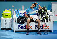 Novak Djokovic (SRB) stretches his neck during a break in play against Kei Nishikori (JPN) during Day One of the Barclays ATP World Tour Finals 2015 played at The O2, London on November 15th 2015