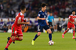 Haraguchi Genki of Japan (C) in action during the AFC Asian Cup UAE 2019 Group F match between Oman (OMA) and Japan (JPN) at Zayed Sports City Stadium on 13 January 2019 in Abu Dhabi, United Arab Emirates. Photo by Marcio Rodrigo Machado / Power Sport Images