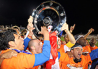 Players of the Puerto Rica Islanders with the championship trophy during the second leg of the USSF-D2 championship match against theCarolina Railhawks at WakeMed Soccer Park, in Cary, North Carolina on October 30 2010.