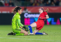 CARSON, CA - FEBRUARY 7: Emily Alvarado #12 of Mexico saves the ball away from Rose Lavelle #16 of the United States during a game between Mexico and USWNT at Dignity Health Sports Park on February 7, 2020 in Carson, California.