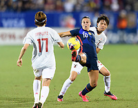 FRISCO, TX - MARCH 11: Carli Lloyd #10 of the United States reaches out to gain control of a loose ball with Moeka Minami #5 of Japan behind her during a game between Japan and USWNT at Toyota Stadium on March 11, 2020 in Frisco, Texas.