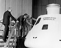 04/01/1974 - File Photo - President Richard M. Nixon is given a briefing on the Apollo Command Module similar to the one that will be flown on the upcoming joint U.S./U.S.S.R. Apollo-Soyuz test flight in the summer of 1975. Conducting the tour is the American Commander for the flight, astronaut Thomas P. Stafford. Standing at the President's right is Dr. James C. Fletcher, NASA Administrator.