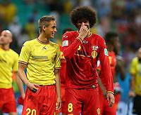 Manchester United team mates Adnan Januzaj and Marouane Fellaini of Belgium share a joke at full time