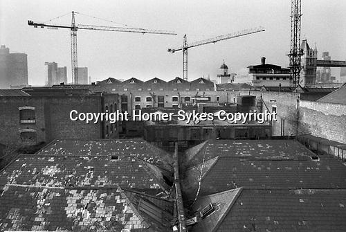 Butlers Wharf  building the London Docklands Development 1980s UK.  Derelict warehouses Southwark, Bermondsey, South East London. 1987