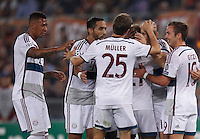 Calcio, Champions League, Gruppo E: Roma vs Bayern Monaco. Roma, stadio Olimpico, 21 ottobre 2014.<br /> Bayern's Arjen Robben, second from right, celebrates with teammates after scoring during the Group E Champions League football match between AS Roma and Bayern at Rome's Olympic stadium, 21 October 2014.<br /> UPDATE IMAGES PRESS/Isabella Bonotto
