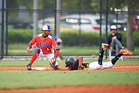 Fabian Lopez (4) waits for a throw as Sandy Sanchez (1) slides into third base during the Dominican Prospect League Elite Florida Event at Pompano Beach Baseball Park on October 15, 2019 in Pompano beach, Florida.  (Mike Janes/Four Seam Images)