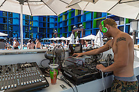 Las Vegas, Nevada.  Disk Jockey Managing the Music around the Linq Pool.  Note Ear Ring.