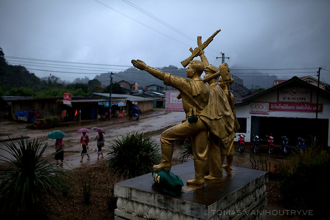 """A statue of three Communist revolutionaries is seen in Vieng Xai in Hua Phan province, Laos on March 17, 2011. A bomb painted with the letters """"USA' rests under the foot of the figure on the left."""