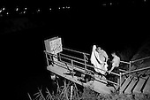 Calexico, California<br /> USA<br /> August 21, 2007<br /> <br /> Just after dusk a Mexican man is pulled from a city canal. He drowned attempting to cross into the US from Mexicali, Mexico.