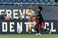 FOXBOROUGH, MA - AUGUST 21: Scott Thomsen #3 of Richmond Kickers and Isaac Angking #5 of New England Revolution II battle for the ball during a game between Richmond Kickers and New England Revolution II at Gillette Stadium on August 21, 2020 in Foxborough, Massachusetts.