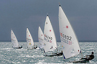 Laser Radials sail boats race one another.