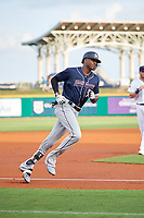 Jacksonville Jumbo Shrimp center fielder Lewis Brinson (32) rounds the bases after hitting a home run in the top of the first inning during a game against the Pensacola Blue Wahoos on August 15, 2018 at Blue Wahoos Stadium in Pensacola, Florida.  Jacksonville defeated Pensacola 9-2.  (Mike Janes/Four Seam Images)