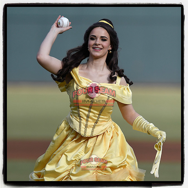 """When you go to the ballpark you never know who's going to throw out the ceremonial first pitch. This is Belle, a Disney character at """"Princess Knight""""  at a  Columbia Fireflies game . . . and I believe she may be throwing a changeup. (Tom Priddy/Four Seam Images)"""